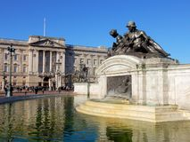 London, Buckingham Palace and Victoria Memorial. London, Buckingham Palace official residence of the British Queen and Victoria Memorial basin with water and stock photo