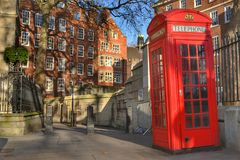 London buildings red telephone box. An alley in London with buildings and red telephone box around it Royalty Free Stock Images