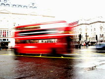 London Bus. A shot of a traditional red London bus in motion. The background is purposely over-exposed to gain the bus movement and also to make the bus 'pop