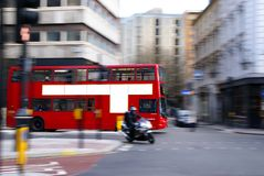 London Bus 2. Bus with motion blur and blank advert area on the side stock image