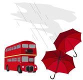 London Bus And Umbrellas Stock Image