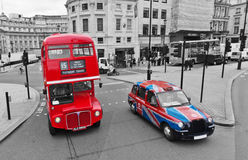 London bus and cab. With selective colors, on a black and white London cityscape