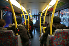 London Bus Commuter. London, UK - February 27, 2011: Interior of London Dobule Decker Bus, passengers are seating on lower deck Royalty Free Stock Photography