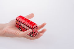 London Bus in hand Royalty Free Stock Image