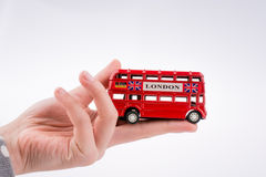 London Bus in hand Stock Image
