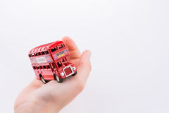 London Bus in hand Stock Photography