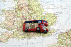 London bus magnet over England map. A London Bus fridge magnet placed on map of England Stock Photo