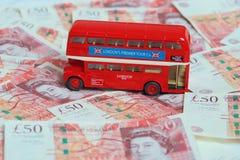 London bus on money. Stock Photo