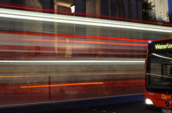 London Bus at night. London buses passing by St Paul's Cathedral on St Paul's Church Yard Royalty Free Stock Image