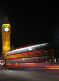 London bus at night. London bus passes the Parliament at night Royalty Free Stock Photos