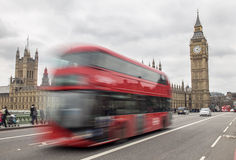 London bus passing Big Ben Stock Photo