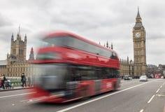 London bus passing Big Ben Stock Photo