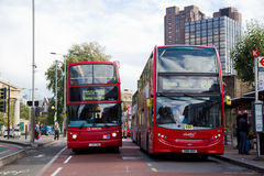 London bus station. LONDON - OCTOBER 11TH: London buses at Waterloo station onOctober 11th, 2014 in London, England, uk. Traveling by bus is london cheapest mode Stock Photo