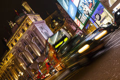 London Bus and Taxi at Night, Piccadilly Circus Royalty Free Stock Images