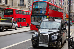 London bus and Taxi Regent Street W1. Westminster in UK England Stock Image