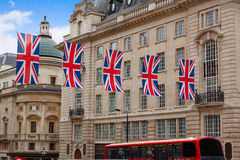 London Bus and UK flags in Piccadilly Circus Royalty Free Stock Image