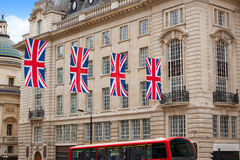 London Bus and UK flags in Piccadilly Circus Stock Photography