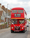 London bus wedding. Photo of a london route master double decker bus with wedding party on board travelling through the streets of whitstable in kent Stock Photography