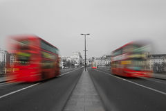 London Buses. London Red Buses on a road in London blurred by motion stock photos