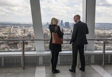 LONDON,  Business people watching London skyline Stock Image