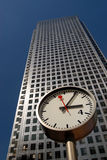 London Business Time. Skyscraper in London's business and financial district, with clock at street level Royalty Free Stock Photo