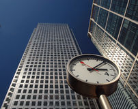 London Business Time. Skyscraper and offices in London's business and financial district, with clock at street level Royalty Free Stock Photo