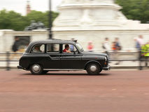 London cab. London black taxi in motion Royalty Free Stock Images