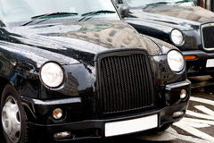 London Cab. London raining day and two London cabs Royalty Free Stock Photo