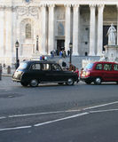 London cab 2. London cabs Red and traditional black royalty free stock images