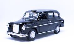 London cab toy. London cab machete on white backgroud stock photos