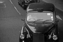 London cab. Traditional black taxis on street Royalty Free Stock Photo