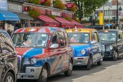 London Cabs waiting at the traffic light Stock Photos