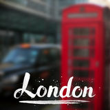 London calligraphy sign on blurred photo Royalty Free Stock Image