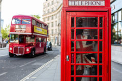 London Calling. Union Jack with typical phone booth & london double deck bus Royalty Free Stock Photos