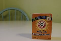 London, Canada - January 01 2019: Editorial illustrative photo of a container of arm and hammer baking soda. Baking soda. Is popular in cooking and cleaning stock photography