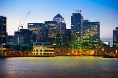 London, Canary Wharf business district in dusk Stock Images