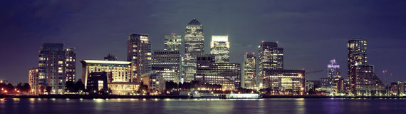 London Canary Wharf at night. Canary Wharf business district in London at night over Thames River Stock Photography