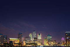 London, Canary Wharf in night with lights reflection in Thames water Royalty Free Stock Images