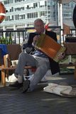 London Canary Wharf 17 Sept 2017. Old man sings and play song. Royalty Free Stock Images