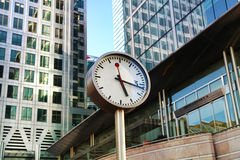 LONDON, CANARY WHARF UK - APRIL 13, 2014 - Clock main square Royalty Free Stock Image