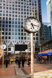 LONDON, CANARY WHARF UK - APRIL 13, 2014. Clocks on the main square Royalty Free Stock Photo