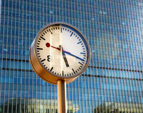 LONDON, CANARY WHARF UK - APRIL 13, 2014. Clocks on the main square Stock Image