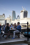 LONDON, CANARY WHARF UK - APRIL 13, 2014 - Office workers chilling up after working day. Modern glass architecture of Canary Wharf Royalty Free Stock Photo