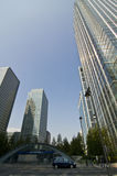 London Canary Wharf wide view. London Canary Wharf business center with a car and blue sky Royalty Free Stock Images