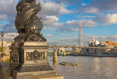 London - The candelabra of Thames promenade, Millennium bridge and Shard in evening light Royalty Free Stock Images