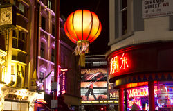London China Town. London, UK - December 30, 2013: Chinese lantern in Gerrard Street and poster of Les Miserables on a theater in China Town in London, UK on Royalty Free Stock Photo