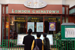 London Chinatown. London, United Kingdom - 26th September, 2006: People reading menu in front of chinese restaurant at Gerrard Street in London Chinatown Stock Photo
