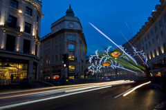 London before Christmas. London, United Kingdom - December 14, 2013: Evening on busy Regent Street in London with Christmas lights and light trails Stock Image