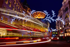 London before Christmas. London, United Kingdom - December 14, 2013: Evening on busy Regent Street in London with Christmas lights and light trails Royalty Free Stock Image