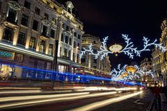 London before Christmas. London, United Kingdom - December 14, 2013: Evening on busy Regent Street in London with Christmas lights and light trails Stock Photography